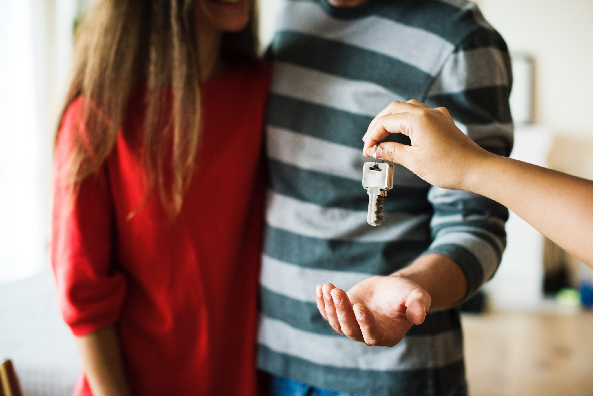 giving house keys to a couple