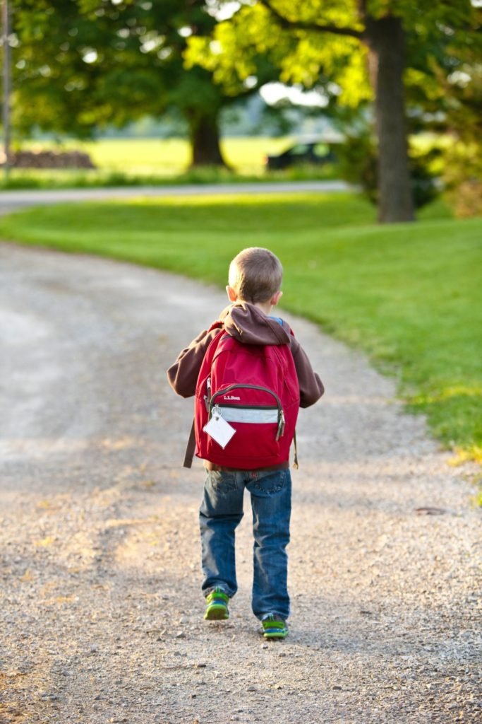 boy with backpack save money on back to school 2020
